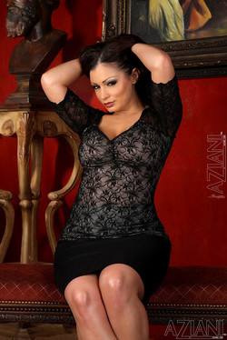 Aria Giovanni Performs Sultry Striptease in Red Room