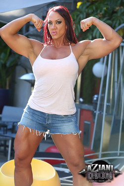 Amber Deluca Ripped Bodybuilder Flexes Tanned Muscles Outdoors