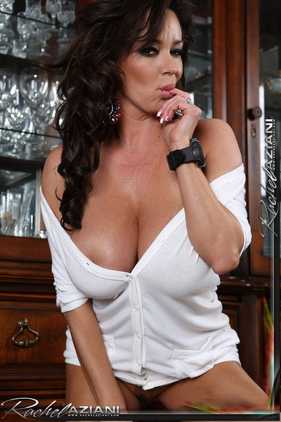 Rachel Aziani Pops Richly Tanned Boobs out of White Dress