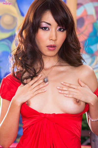 Marica Hase Asian Brunette Bares Breasts and Curvy Behind
