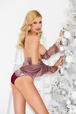 Kennedy Summers December Playmate Trims Christmas Tree