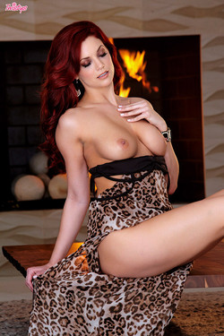 Jayden Cole Hot Redhead Bares Busty Bod by the Fireplace