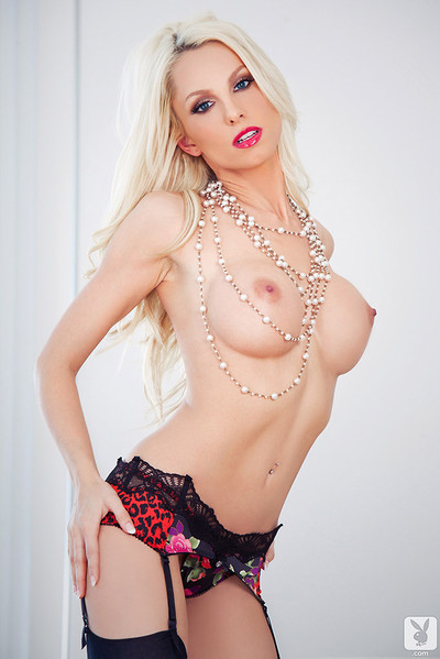 Kyara Tyler Sheds Floral Lingerie to Flaunt 34D Breasts