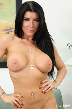 Romi Rain Feisty Brunette Bares Big Boobs with Playful Striptease