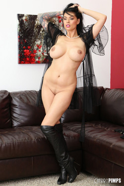 Tera Patrick Hall of Fame Pornstar Bares Boobs and Boots