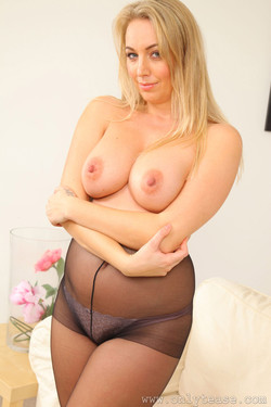 Hayley Marie Coppin Shows Off Soft Curves in Pantyhose