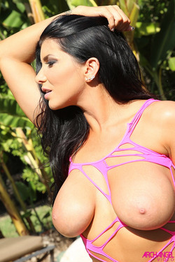 Romi Rain Shows Off Whopping Breasts in Shallow Pool