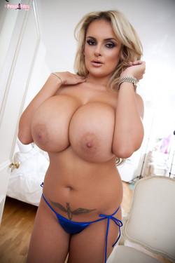 Katie Thornton Displays Jaw-Dropping J-Cups from Blue Bikini