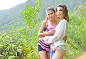 Brunette hotties Kristen and Nina play with a toy while hiking in Hawaii