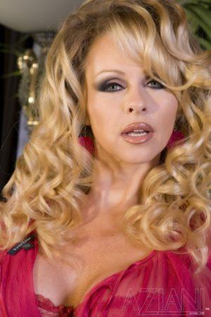 Dyanna Lauren in a Red Hot Strip