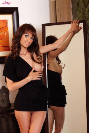 Roxanne Milan Shows off in a Black Dress