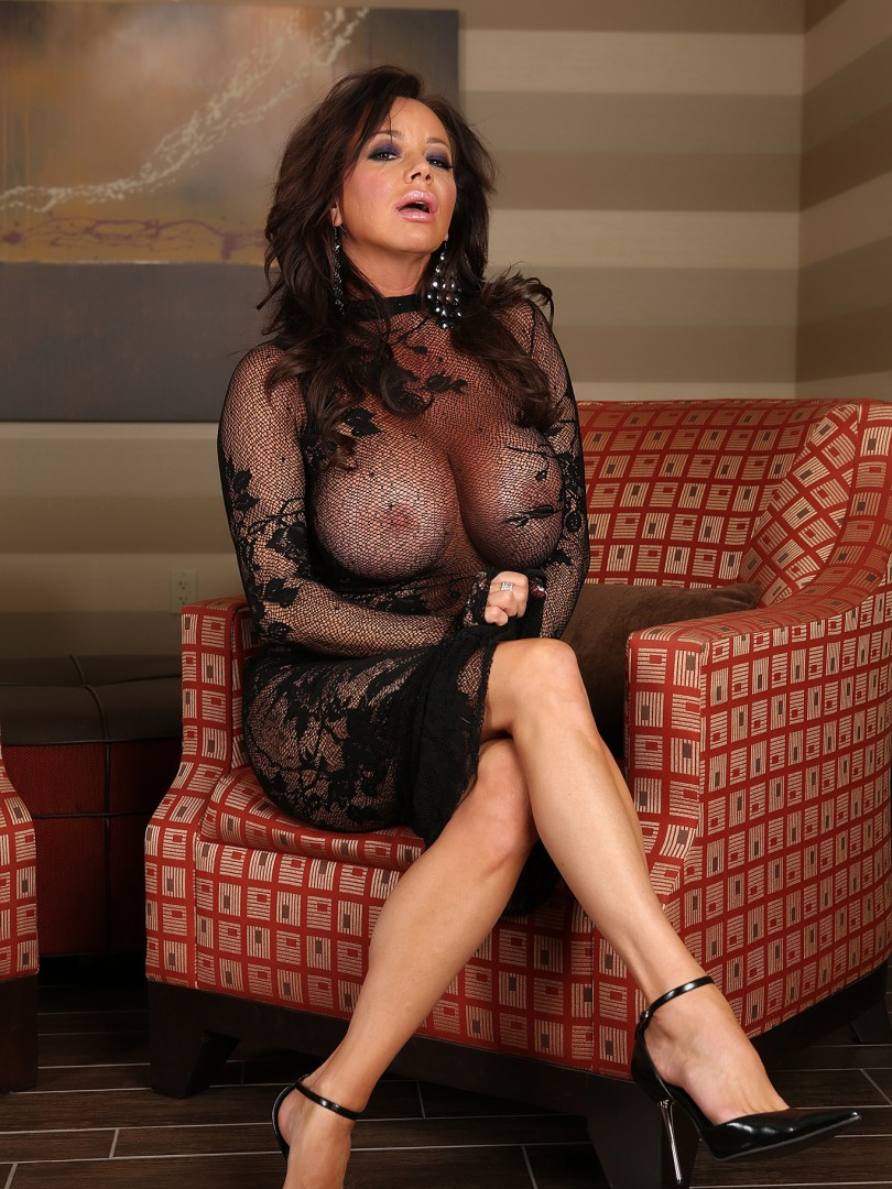 Rachel Aziani Busts Out of Sheer Lace Dress