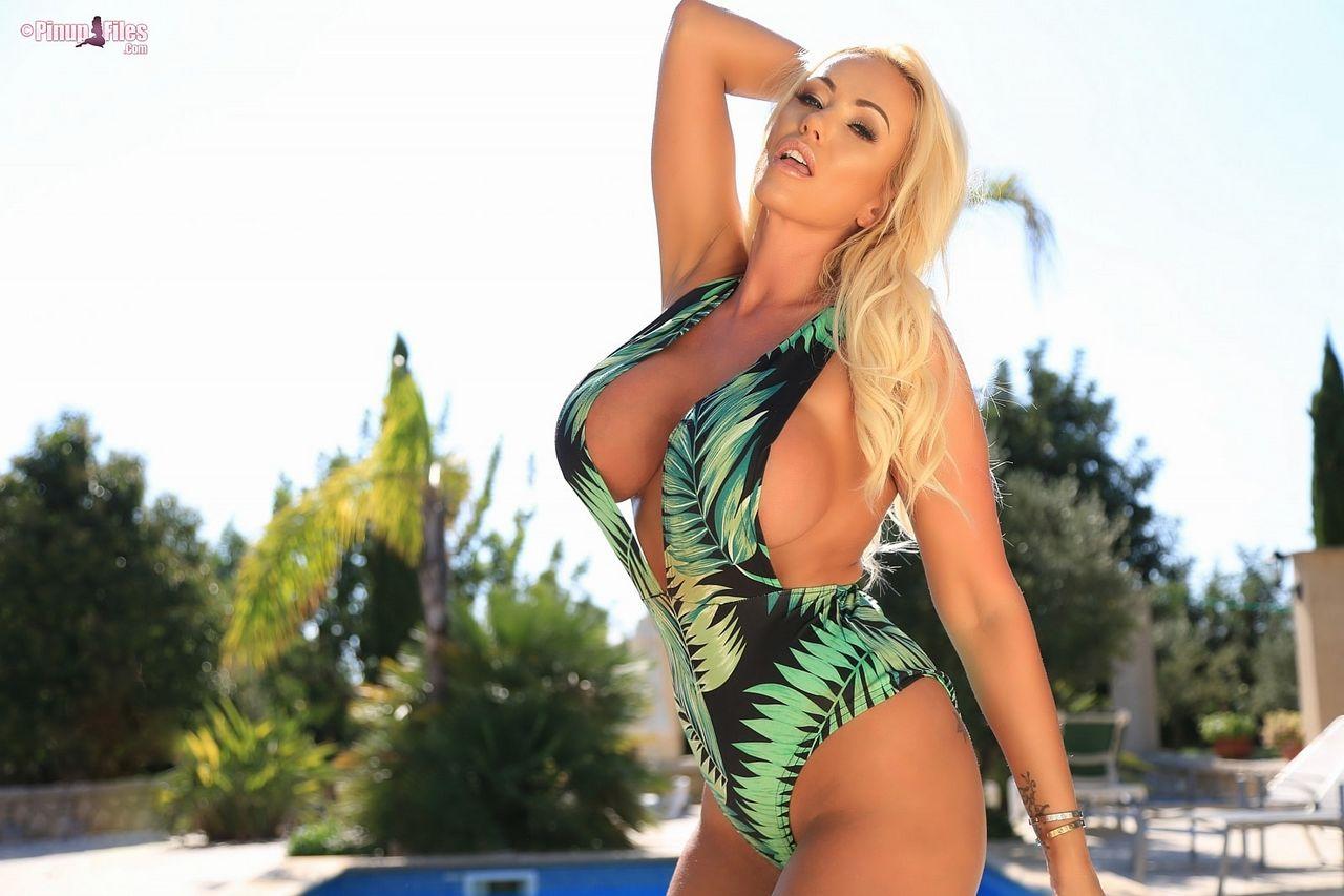 Lucy Zara Busty Babe in Green Swimsuit