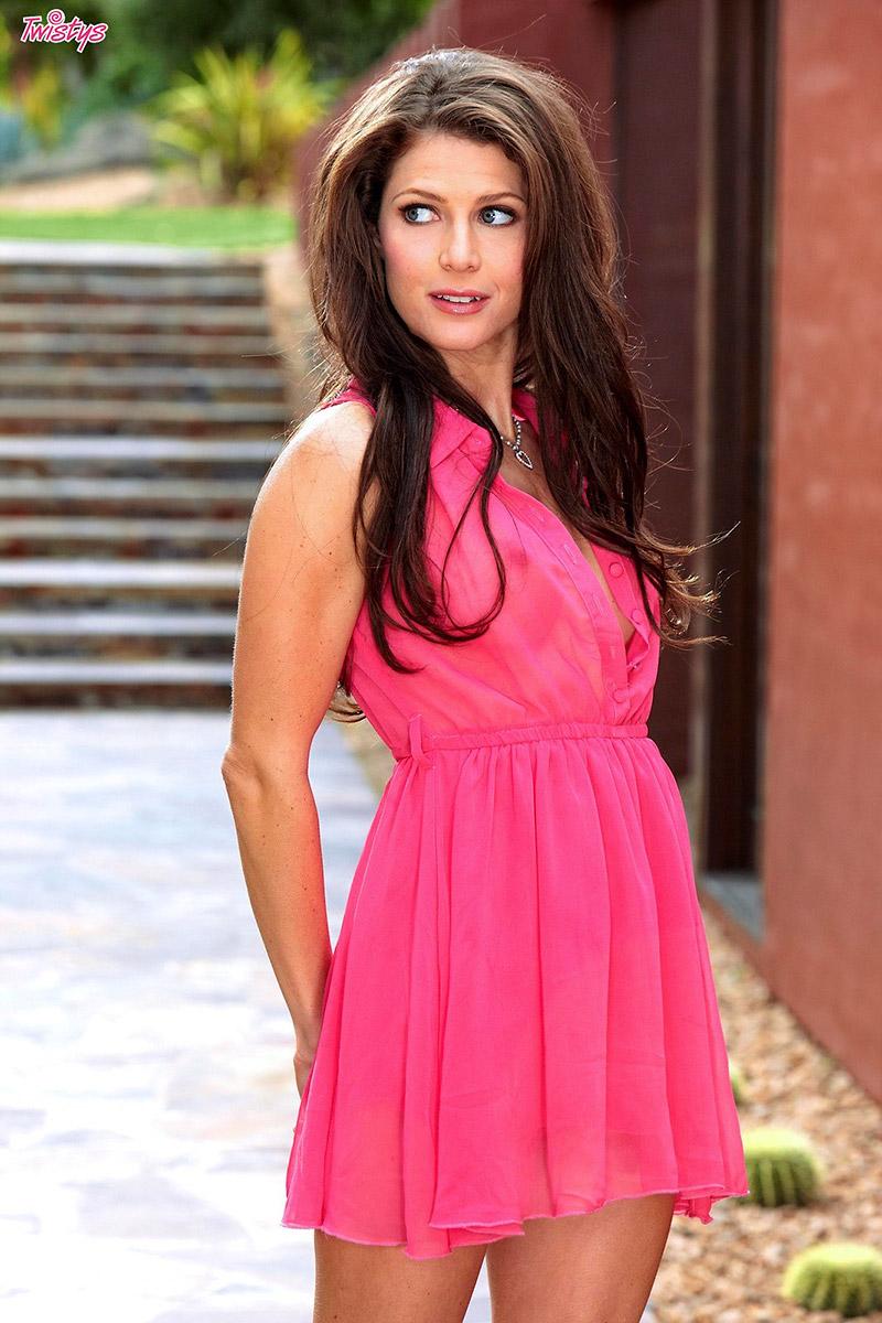 Jenni Lee Svelte and Shapely Brunette Dashes Pink Dress